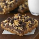 Ghirardelli(R) Magic Cookie Bars - Layers of graham cracker crumbs, coconut, chocolate chips and nuts bake up into sweet, delicious treats--magically without a single mixing bowl!