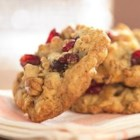 Cranberry Walnut Oatmeal Cookies - Oatmeal cookies taken to a new level, these buttery cookies are loaded with dried cranberries and nuts and a dash of cinnamon.