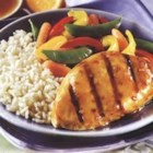 Asian Grilled Chicken - Swanson(R) Broth balances the vinegar and soy in the marinade to create moist grilled chicken that is served with its own light sauce.