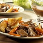 Weekday Pot Roast and Vegetables - Use Campbell's(R) Beef Gravy to make a satisfying and delicious pot roast in the slow cooker for your hungry family.