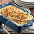 Mashed Potato Casserole - Wake up your mashed potatoes with Cheddar cheese, sour cream, chives, and a topping of fried onions and bacon. It's like a stuffed potato in a casserole dish!