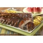 Hoot-n Holler Baby Back Pork Ribs - These mesquite-and bay-flavored baby-back ribs are brushed with your favorite barbecue sauce and grilled to perfection.