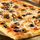 Mexican Pizza - A Pepperidge Farm(R) Puff Pastry Sheet is topped with both Prego(R) Traditional Italian Sauce and picante sauce, mozzarella and Cheddar cheeses and sliced ripe olives.