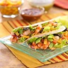 Grilled Shrimp Tacos - Hot, grilled shrimp are dressed with a sauce made from Taco Ranch Dressing, and served on warmed flour tortillas.
