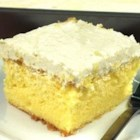 Lemon Cooler Cream Cake - Lemon cake infused with lemon gelatin and topped with a cool, whipped topping, then served cold.
