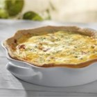 Turkey, Red Pepper and Cheddar Quiche - Aged Canadian Cheddar adds a zip of flavour to turkey while the green onions and roasted red peppers add colour and texture. With a few pantry staples like cream and eggs, a family favourite is whipped up for a weekend brunch or easy dinner.