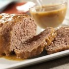 Simply Delicious Meat Loaf and Gravy - The name says it all - this family-pleasing meat loaf is made special and scrumptious with golden mushroom soup.