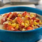 Crab and Corn Chowder - This scrumptious soup features corn and crabmeat mixed with bacon, potatoes, onion and garlic simmering together in a flavorful combination of Swanson(R) Chicken Broth and heavy cream.