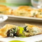 Spinach and Feta Mini-Calzones - Feta cheese and spinach are wrapped in flaky Pepperidge Farm(R) Puff Pastry in this tasty appetizer. Good thing they're easy to prepare because they're sure to disappear fast.