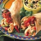 Monterey Chicken Fajitas - Stir-fried chicken strips, peppers and onions are simmered in a zesty sauce and wrapped in warm tortillas.