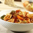 Tortellini-Vegetable Toss - Cheesy ravioli and colorful vegetables are laced with Prego(R) Garden Combination Pasta Sauce for an easy, satisfying two-step supper.