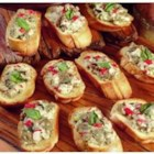 Jimmy Dean Sausage Crostini - Toasted rounds of sliced French bread are topped with a mixture of sausage, mozzarella cheese, sweet red peppers and fresh basil.