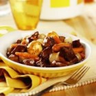 Slow Cooker Simple Beef Bourguignonne - Pieces of beef top round get fork-tender when they're slow cooked together with red wine, golden mushroom soup and vegetables to make this savory and delicious stew.