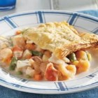 Seafood Pot Pie - Break into the flaky puff pastry crust and you'll find a delectable pot pie filling packed with shrimp, imitation crabmeat and lots of vegetables. It's an impressive dish . . . and only you'll know how easy it is to make!