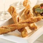 Sweet and Spiced Straws - Pepperidge Farm(R) Puff Pastry Sheets are sprinkled with a sweet and spicy combination of sugar, cinnamon, red pepper and paprika, cut into strips, twisted and baked until the pastry is golden.