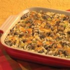 Hearty Sausage and Rice Casserole - Come in from the cold and enjoy this flavorful sausage and rice casserole featuring Swanson(R) Chicken Broth, Campbell's(R) Condensed Cream of Mushroom Soup, savory vegetables and a cheesy topping.