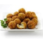 Spinach Arancini - Arborio rice balls with spinach and Parmigiano-Reggiano and a cube of mozzarella cheese inside are rolled in seasoned panko bread crumbs, then deep fried until golden brown for an impressive and delicious appetizer.