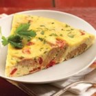 al fresco Roasted Pepper and Asiago Chicken Sausage Frittata - For breakfast, brunch or a light supper, this frittata with sliced chicken sausage, roasted peppers, grated Parmesan and hot sauce is a quick and tasty choice.
