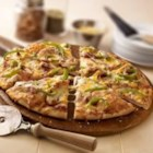 California-Style Barbecue Chicken Pizza - Barbecue sauce, chicken and bell peppers topped with lots of shredded Cheddar make a quick, California-style pizza for lunch, dinner, or a snack.