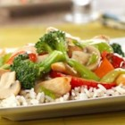 Chicken and Vegetable Stir-Fry - Chicken and a colorful combination of vegetables are quickly stir-fried and served over rice.