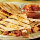 Pace(R) Spicy Grilled Quesadillas - Tender chicken, green onion, Pace(R) Thick & Chunky Salsa and Cheddar cheese are sandwiched in flour tortillas that are grilled until golden.