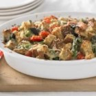 Whole Grain Asparagus and Red Pepper Strata - Packed with veggies and whole-grain goodness, this dish makes a perfect breakfast or brunch.