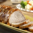 Apricot Glazed Pork Roast - Pork roast slow-cooks to tenderness under a tangy glaze of apricot preserves, mustard, onion and Campbell's(R) Condensed Chicken Broth.