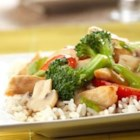 Ginger Chicken Stir-Fry - Tender chicken is sauteed with a colorful mix of broccoli, carrots and onion, then laced with a ginger-spiked sauce featuring Swanson(R) Chicken Broth to be served over brown or white rice.