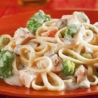 Chicken and Broccoli Alfredo - Linguini is mixed with pieces of tender chicken and broccoli flowerets and coated with a rich, satiny Alfredo sauce featuring Campbell's(R) Condensed Cream of Mushroom Soup to make a quick and fabulous dish.