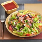 Blackened Steak Salad with Berry Vinaigrette - Seasoned, grilled flat iron steak is thinly sliced and served atop a romaine salad studded with roasted red peppers and feta cheese.