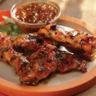 Grilled Chicken Wings with Sweet Red Chili and Peach Glaze - These succulent chicken wings are grilled with a glaze of peach-apricot preserves, Thai sweet red chili sauce, fresh cilantro and lime juice.