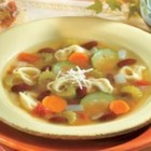 Italian Tortellini Soup - This hearty pasta and bean soup features cheese-filled tortellini, zucchini, tomatoes and other vegetables simmered in chicken broth.