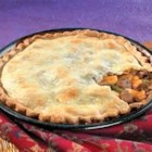 Easy Beef Pot Pie - Convenient cooked beef and vegetables bound with a creamy mushroom gravy are tucked into a flaky pie crust.