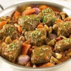 Swanson(R) Braised Beef with Shallots and Mushrooms - Beef is simmered to fork-tenderness in a sauce of rich Swanson(R) Beef Stock, shallots and mushrooms, and is finished with an aromatic topping of lemon and parsley.