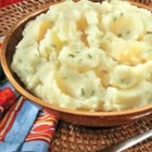 Roasted Garlic Mashed Potatoes - Sweet roasted garlic adds a sophisticated note to perfectly creamy mashed potatoes made lean with Swanson(R)  Chicken Broth.