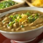 White Chicken Chili - Campbell's(R) Condensed Cream of Chicken Soup and Campbell's(R) Dry Onion Soup and Recipe Mix combine to flavor this scrumptious chili featuring chicken, white kidney beans and chili powder, and served with shredded Cheddar cheese and sliced green onion.