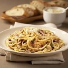Classico(R) Spaghetti Carbonara - An easier take on an Italian classic. Rich and creamy alfredo sauce combines with Parmesan and Pancetta (Italian bacon) for a delicious pasta dish the whole family will love.