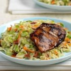 Grilled Chicken with Wilted Slaw - Molasses-marinated chicken thighs are grilled to perfection, then served with a bacony wilted slaw.