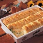 Chicken Biscuit Bake - Golden biscuits cover this homespun dish laden with chicken, broccoli and cheese. It's then topped with a celery seed mixture. 'My family requests this all-in-one dinner once a month,' relates Karen Weirick of Bourbon, Indiana.
