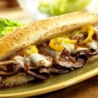 Dripping Roast Beef Sandwiches with Melted Provolone - In less than 15 minutes, you can put together these mouthwatering, restaurant-style sandwiches that get a kick from banana peppers and cheesy goodness from melted provolone. Enjoy!