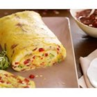 Bacon Omelette Roll with Salsa - This omelette is baked in a jelly-roll pan, topped with shredded cheese, then rolled, sliced and served with salsa.