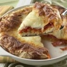 1-Dish Pepperoni Cheese Pizza Bake - Pizza was never easier than this--spread the sauce, pepperoni and cheese on pizza batter and bake for 30 minutes for a savory, deep-dish treat.