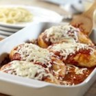 Quick Chicken Parmesan - Chicken is topped with Prego(R) Traditional Italian Sauce, mozzarella and Parmesan cheeses, baked to tenderness and served over spaghetti.