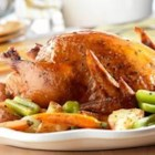 Swanson(R) Rosemary Chicken and Roasted Vegetables - Carrots, celery, onions and potatoes roast alongside herbed chicken moistened with Swanson(R) Chicken Stock and orange juice to create this flavor-infused one-dish supper.
