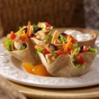 Southwest Salad Taco Cups - Petite, homemade taco cups make crispy bowls for this easy chicken taco salad.
