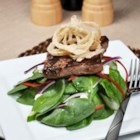 Spinach 'n' Steak Salad with Chipotle Honey Mustard - Salty feta cheese and crunchy fried onions garnish the warm, grilled beef topping this salad.
