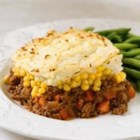 Classic Shepherd's Pie - A savory base of ground beef and vegetables in tangy tomato gravy and topped with a layer of buttery mashed potatoes. It's the perfect comfort food for your hungry family.