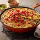 Chorizo, Potato and Green Chile Omelet - Kick start your day with this zesty omelet filled to the brim with spicy sausage, green chile peppers, and melted Mexican-style cheese.