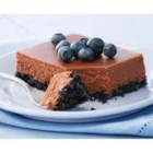 PHILADELPHIA Double-Chocolate Cheesecake - Crushed chocolate sandwich cookies form the base of this creamy, chocolatey cheesecake topped with blueberries.