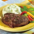 Peppercorn-Seasoned Steaks with Mustard-Wine Sauce - This is the perfect main dish for a special evening. Tenderloin steaks are seasoned with pepper, pan seared and served with a fresh and savory mustard-wine sauce.